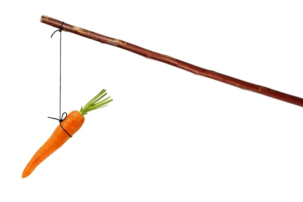 Investing carrot on a stick. Savings is the goal